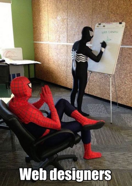 funny photo of spider-man and venom in office as web designers