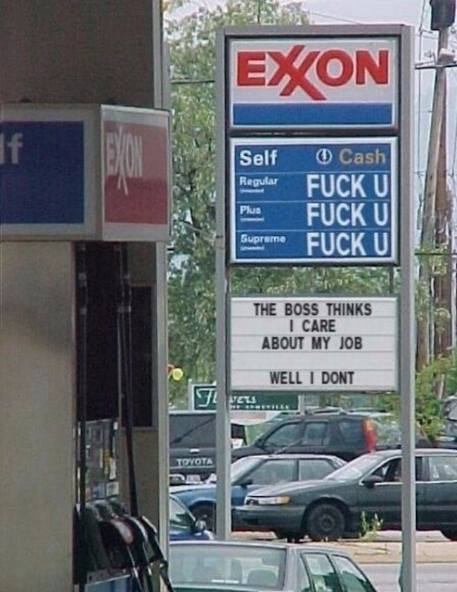 funny picture of gas station sign employee prank
