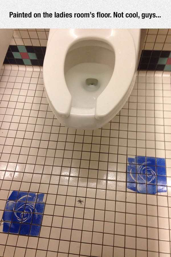 funny photo of spider painted into floor of ladies room