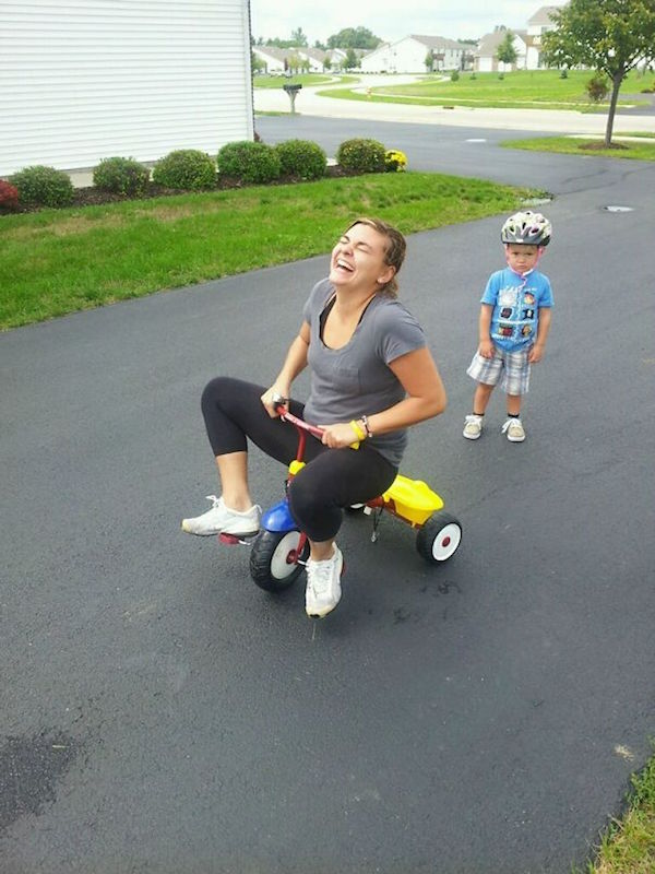 funny image of mom stealing tricycle from kid