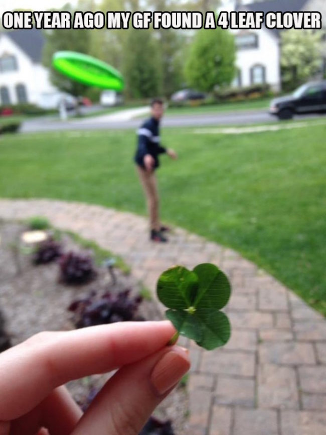 image of girl with four leaf clover about to get hit by frisbee