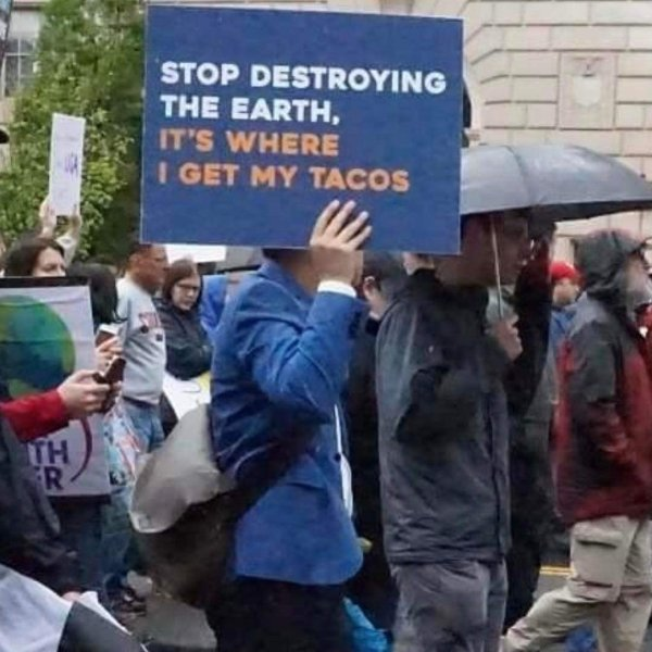 funny picture of stop destroying the earth it's where I get my tacos sign