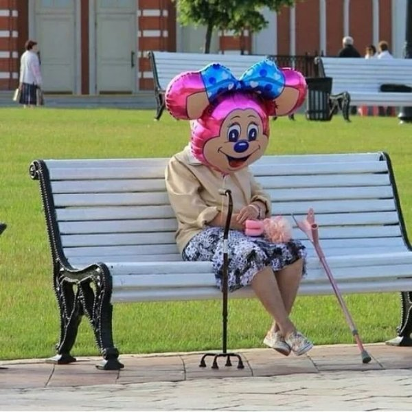 funny pic of perfectly timed mouse balloon over old woman's head