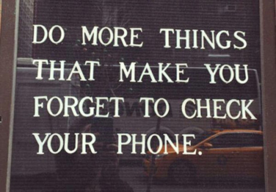 silly pic of sign says do more things that make you forget to check your phone
