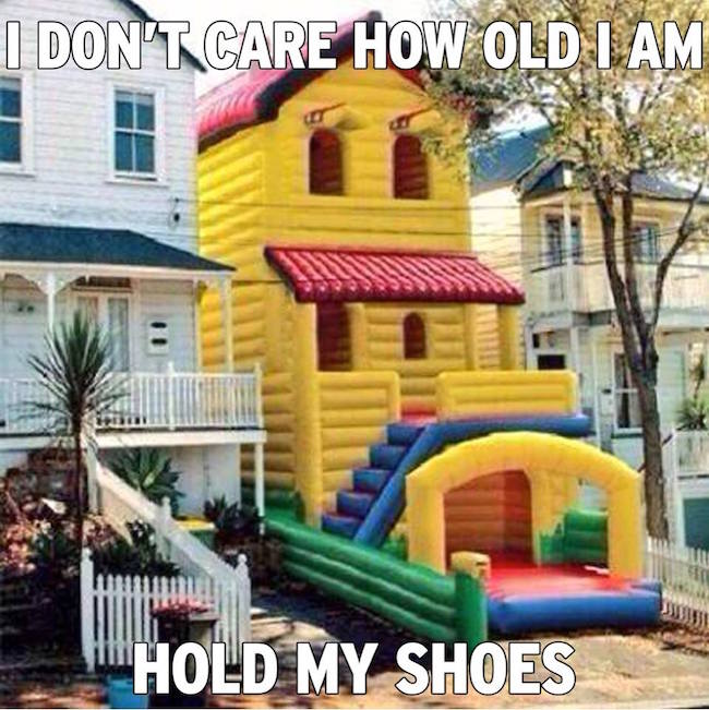 funny pic of bounce house don't care how old I am hold my shoes