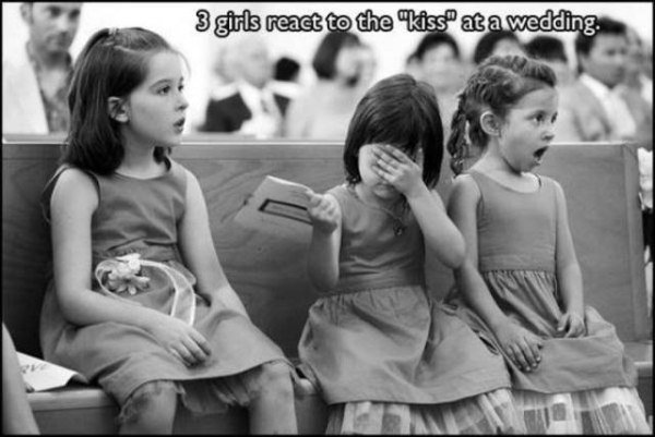 funny pic of three girls react to the kiss at the wedding