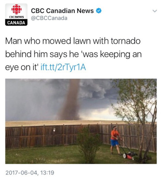 funny image of guy mowing lawn during tornado