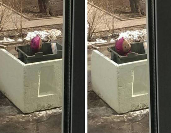 silly photo of weird balloon with face in trash looking through window