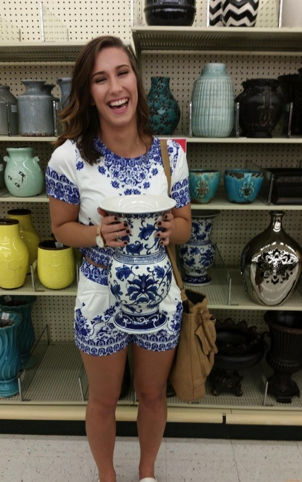 funny pic of girl's outfit matches vase
