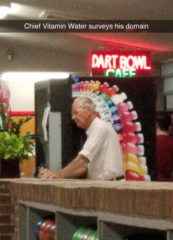 funny image of perfectly timed guy standing in front of vitamin water ad looks like an indian chief