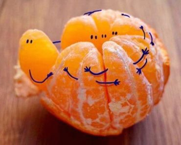 funny pictures of orange slices with hands and eyes drawn on them