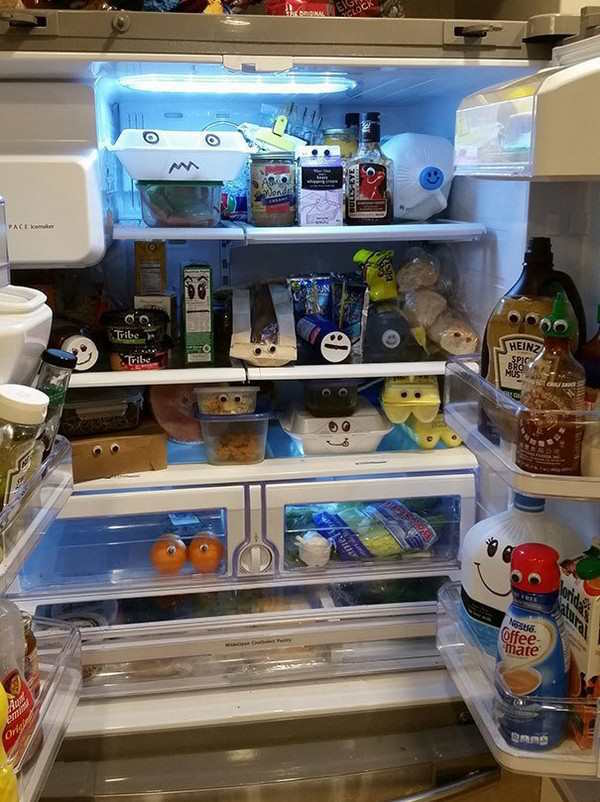 funniest couple prank of googly eyes on items in the fridge