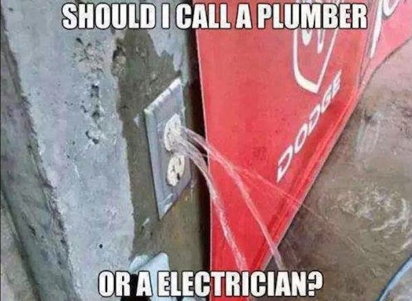 funny photo of outlet leaking water says should I call a plumber or electrician
