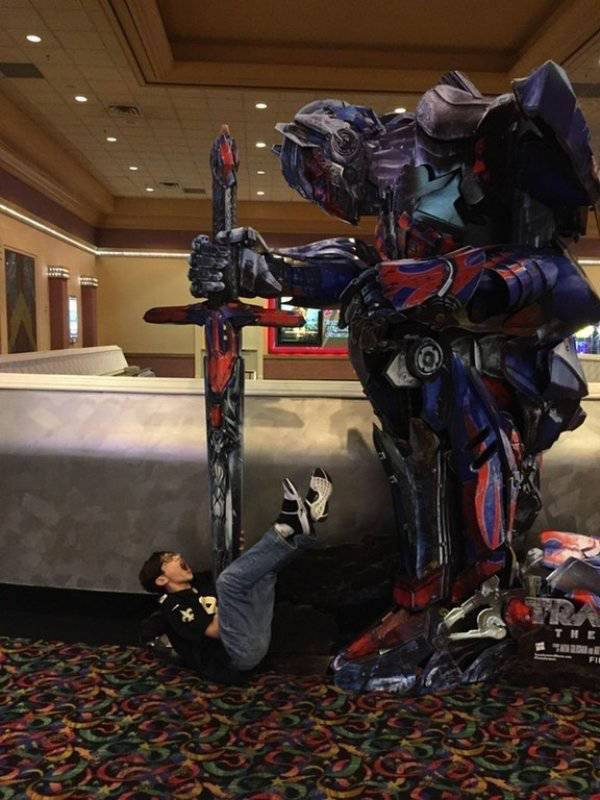 funny pic of transformers movie theater cutout stabbing kid