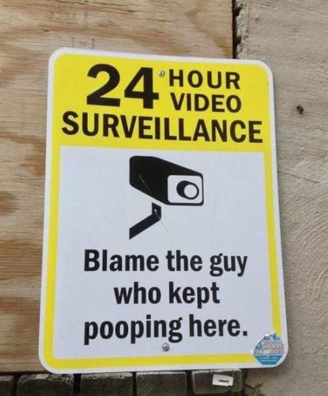 funny image of survellaince sign that says blame the guy who kept pooping here
