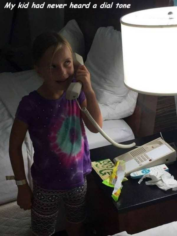 funny photo of little girl hearing dial tone for the first time