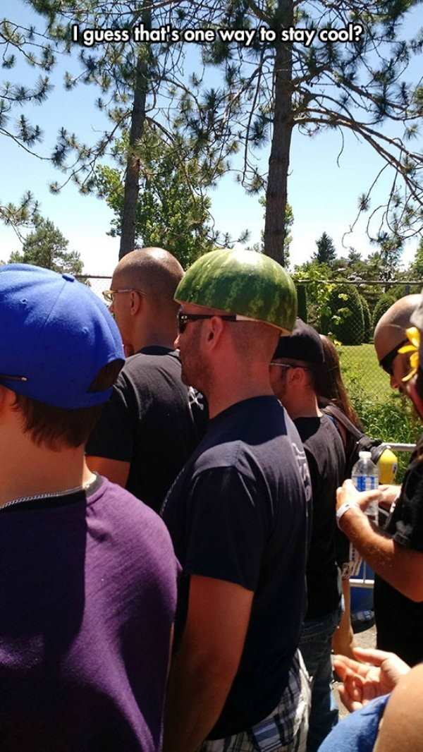 funny pic of man wearing a watermelon helmet