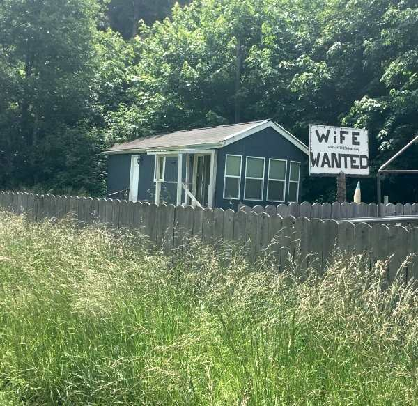 funny pic of sign that says wife wanted