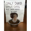 silly photo of cat outsmarts sign that says only dumb little cats put their head in here