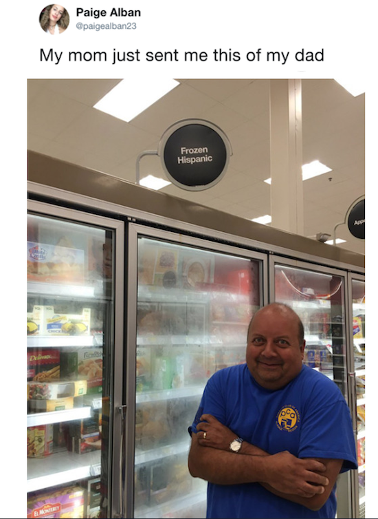 funny picture of dad posing in front of frozen hispanic sign