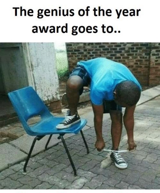 greatest photo of genius of the year award goes to kid tying shoe on floor with foot up on chair