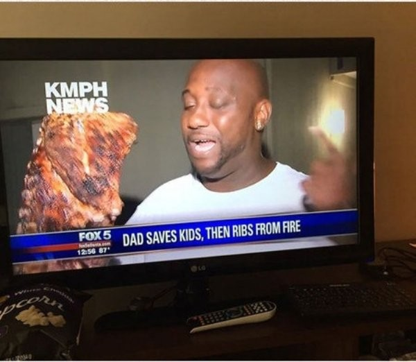 hilarious photo of news headline that says dad saves kids then ribs from fire