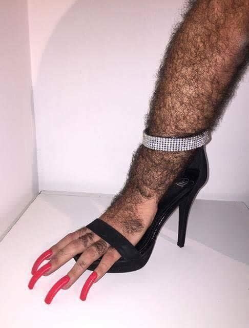 what appears to be hand with long nails in a high heel cursed image, what appears to be a hand with long nails in a high heel cursed picture