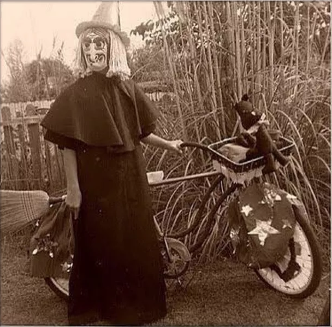 very strange and creepy vintage halloween costume, creepy witch and bike vintage halloween costume