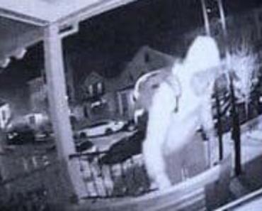 person stealing pillows off a porch