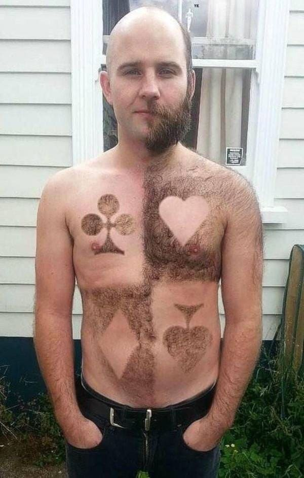 man shaved with playing card symbols on chest and stomach funny picture