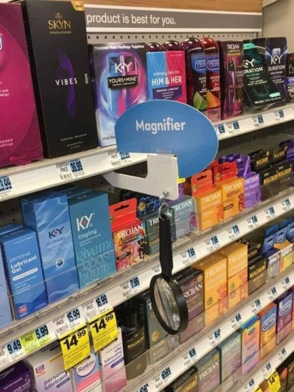 magnifier near condom rack funny picture
