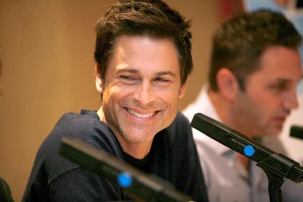 Celebrity weird facts, strange true stories about celebs, celeb facts that will make you rethink them forever, rob lowe smiling with microphone