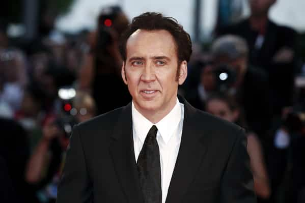 nicolas cage dinosaur bid, Celebrity weird facts, strange true stories about celebs, celeb facts that will make you rethink them forever